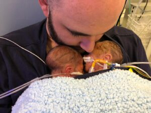 Carl MacDonald with twin sons in NICU
